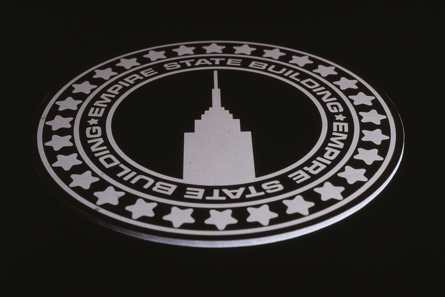 Design of a manhole cover with the Empire State design on it.
