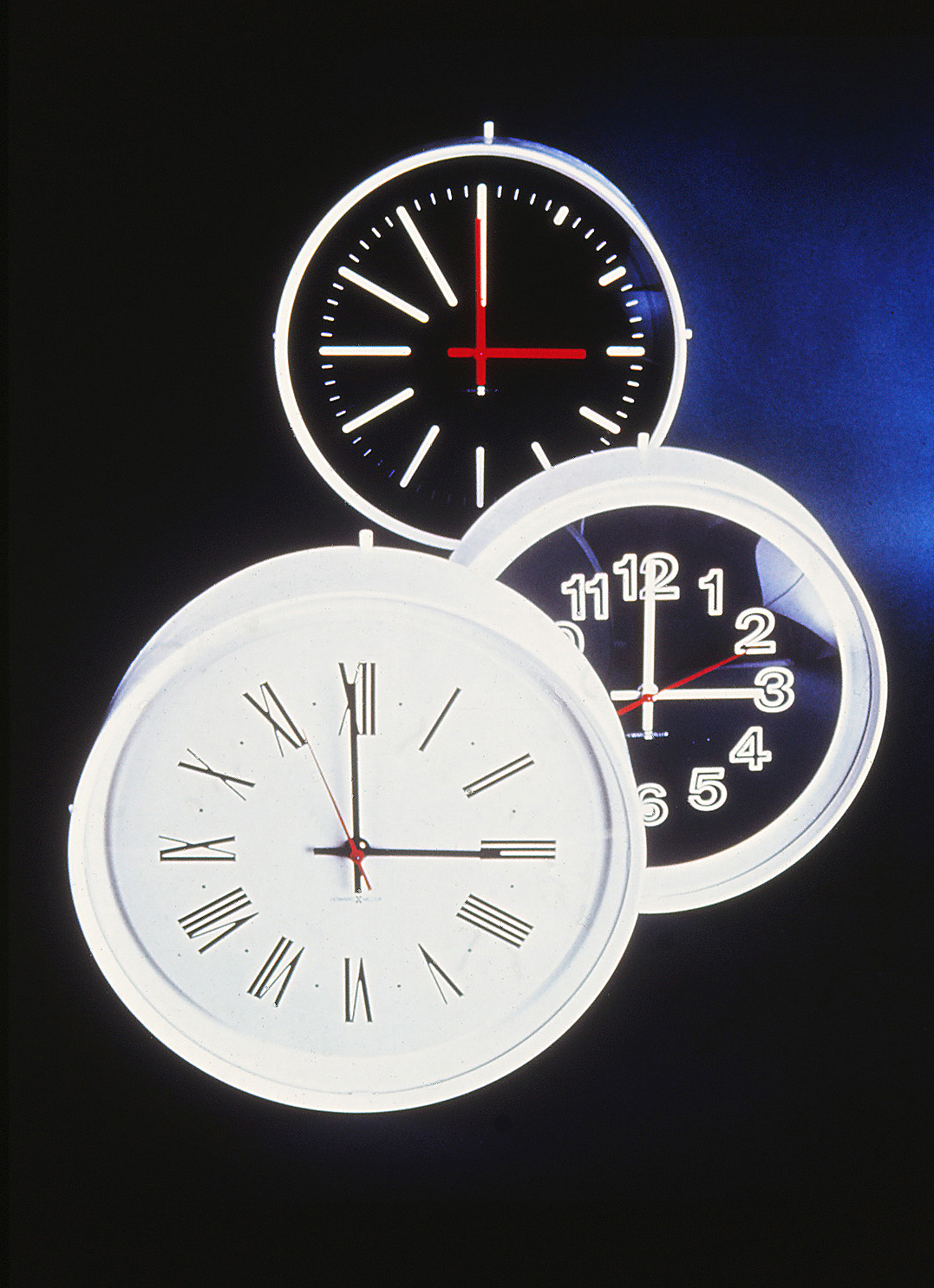 Three Institutional Clocks against a background.