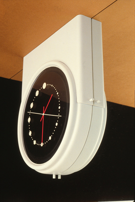 Saddle mounted clock into ceiling concept