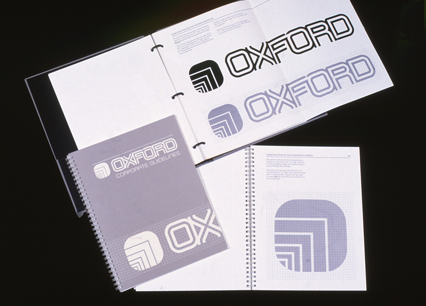 The Oxford Graphic Standards Manual shown indifferent layouts, opened and closed.