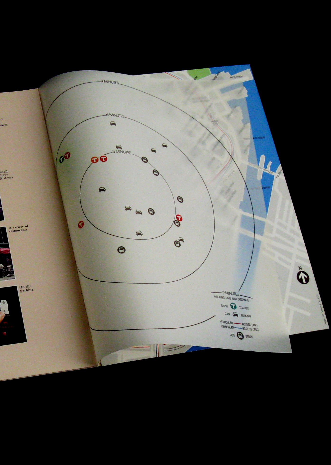Brochure opened to a map page with translucent overlay showing distances and walking times.