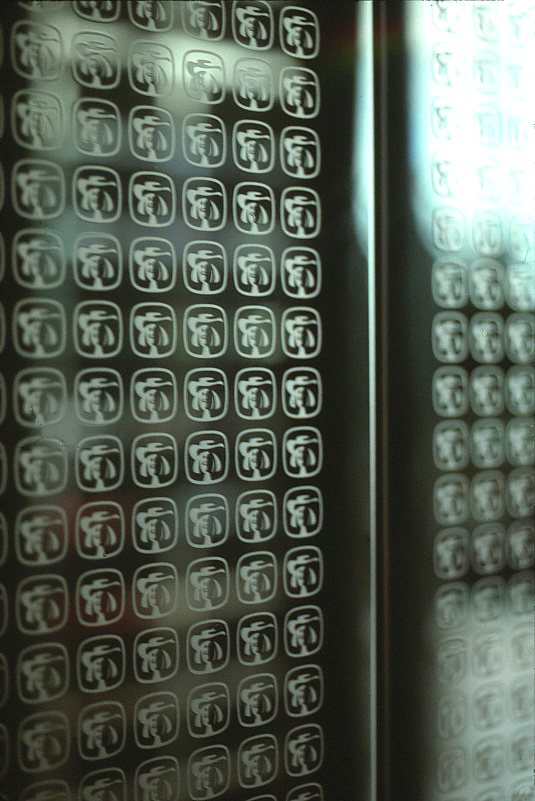 Elevator doors showing the etched repeat pattern of the Quaker Symbol.