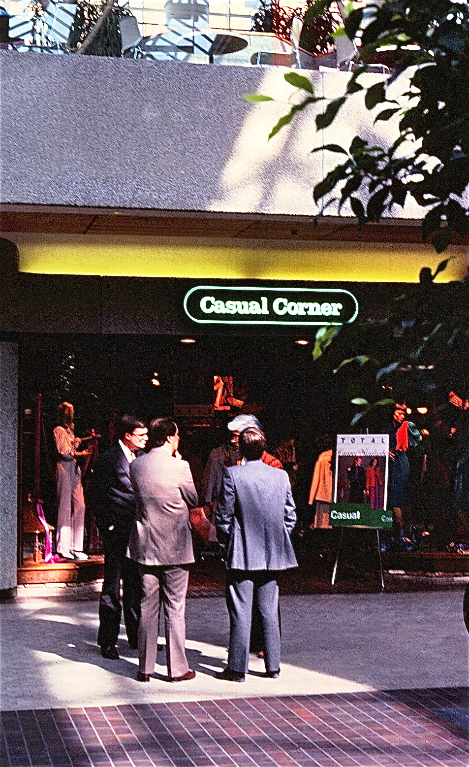 Canopy over an entrance featuring a retail sign standard saying Casual Corner.