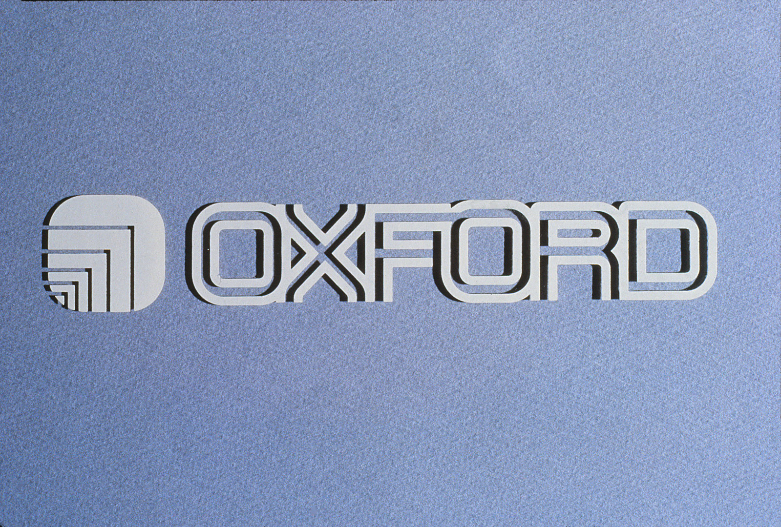 The raised Oxford logo and typeface as it looks on a wall.