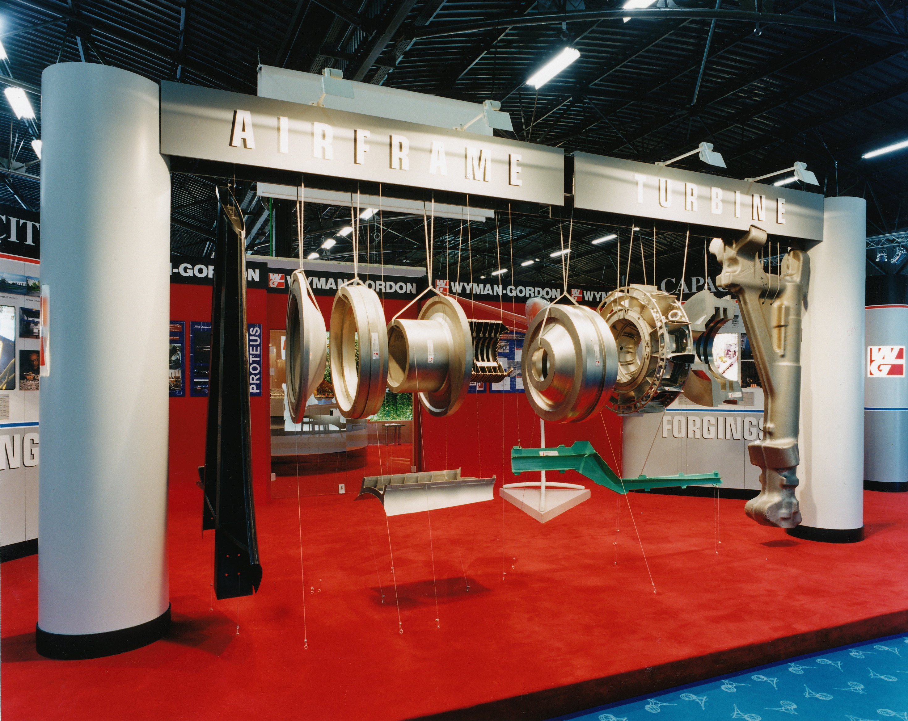 Hanging display of jet engine component parts hanging in an exploded view.
