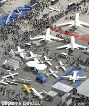 Aerial view of Paris Air Show featuring planes and crowds.