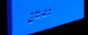 Closeup of raised braille code on the interior signs