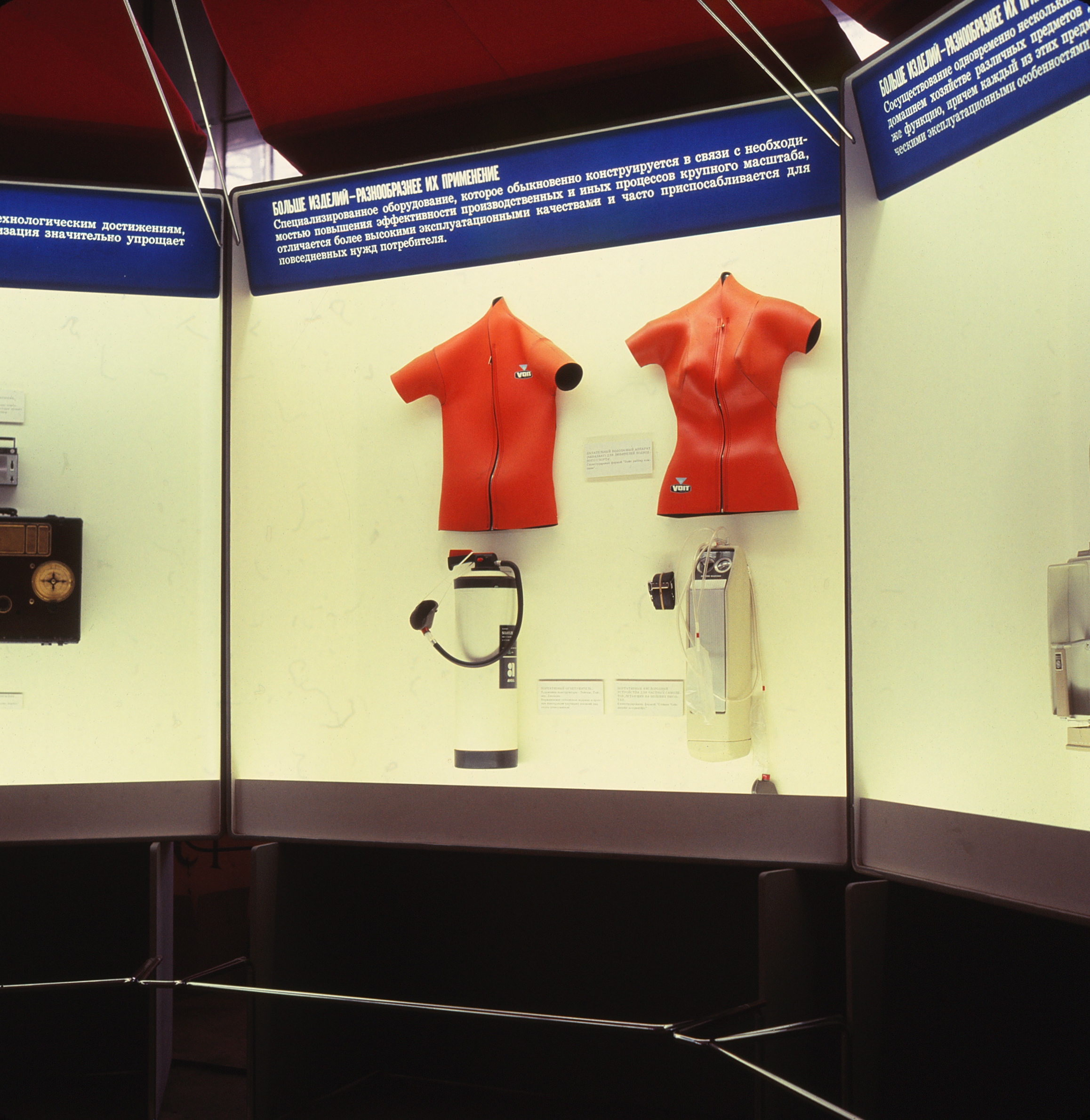 Display cases featuring scuba gear and wetsuits.