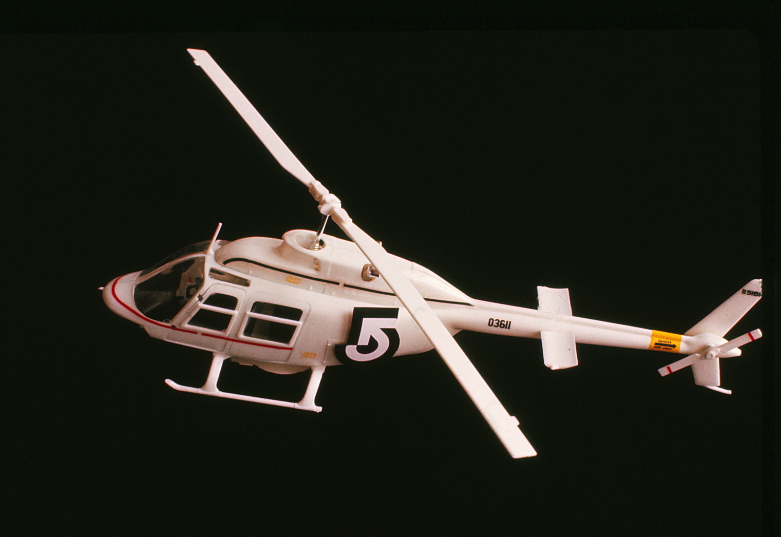 Model of helicopter with logo on it