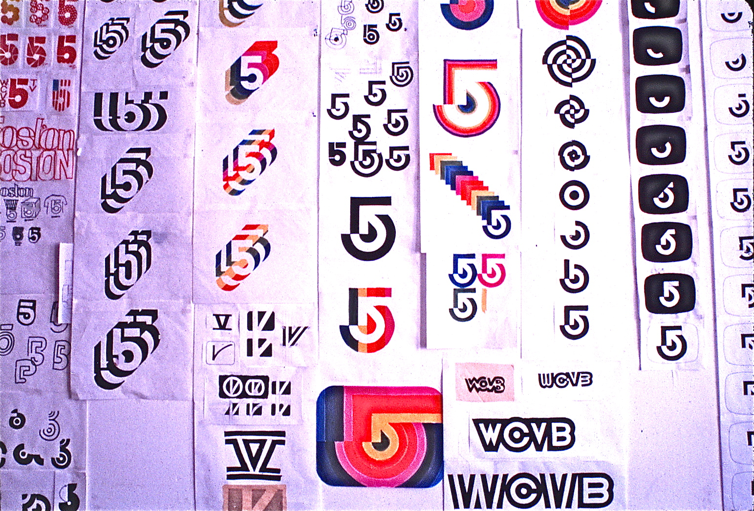 Large board featuring development of logo ideas