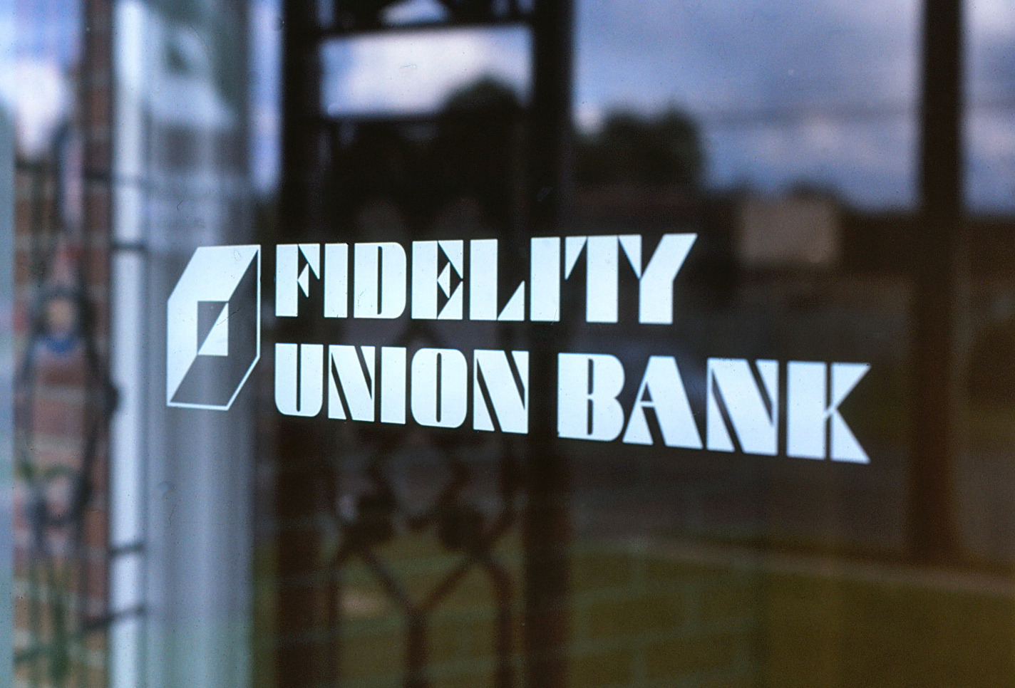 Fidelity Union Bank and logo mounted to a large glass window with white vinyl diecuts.