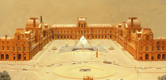 An overview of I.M. Pei's wood model of the Cour Napoleon at the Louvre Museum, which is the central outdoor square.