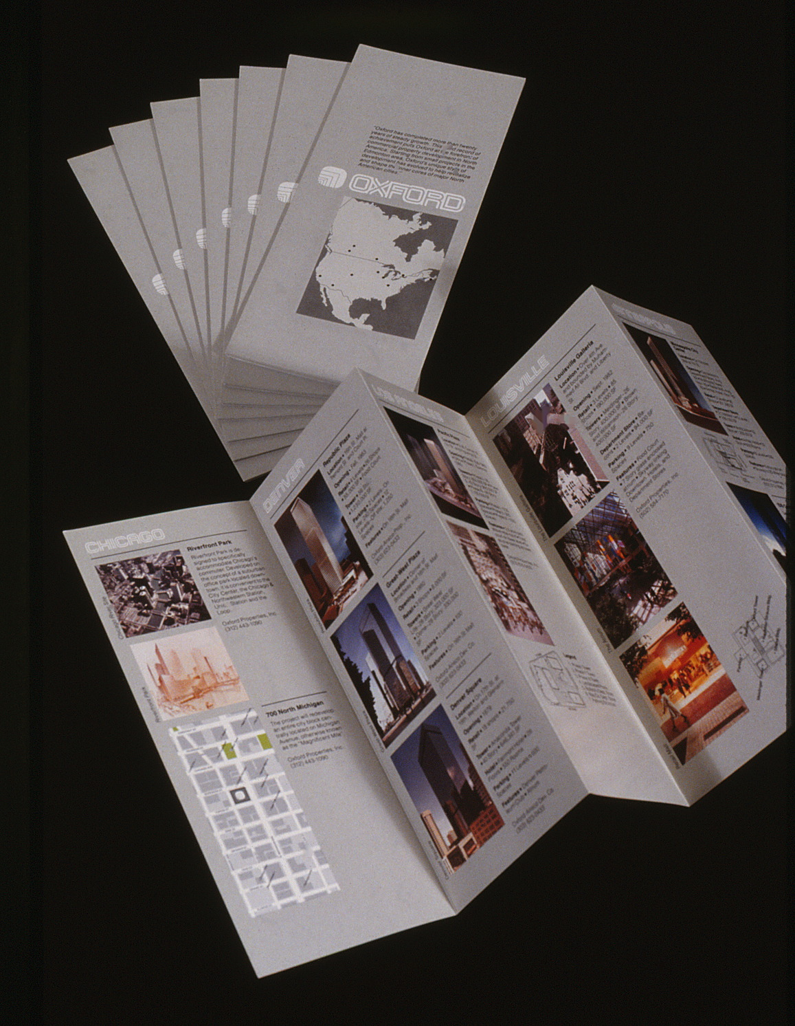 The fold-out brochures shown closed and folded out with multiple spines.