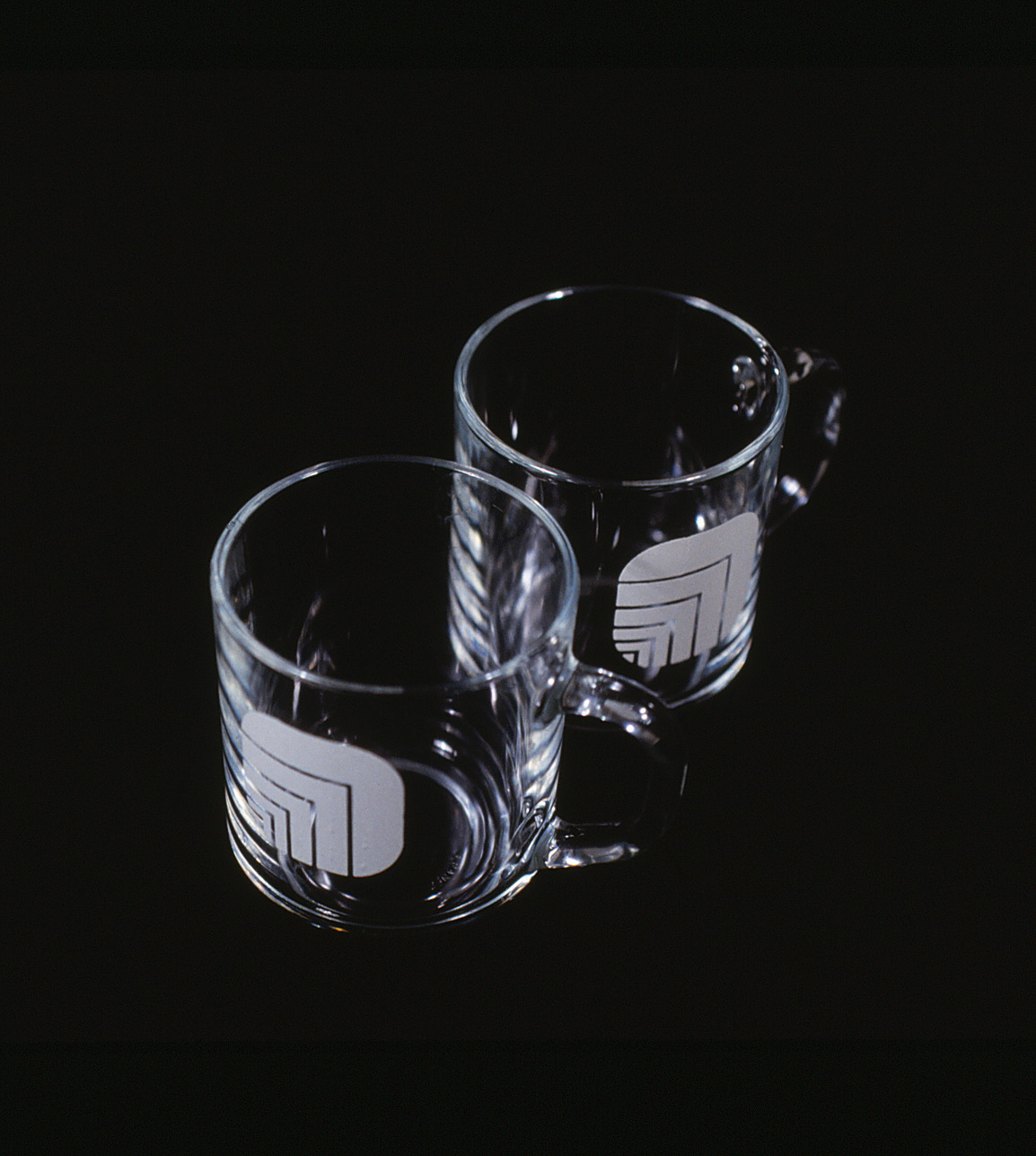 Pair of glass coffee mugs with Oxford logos.