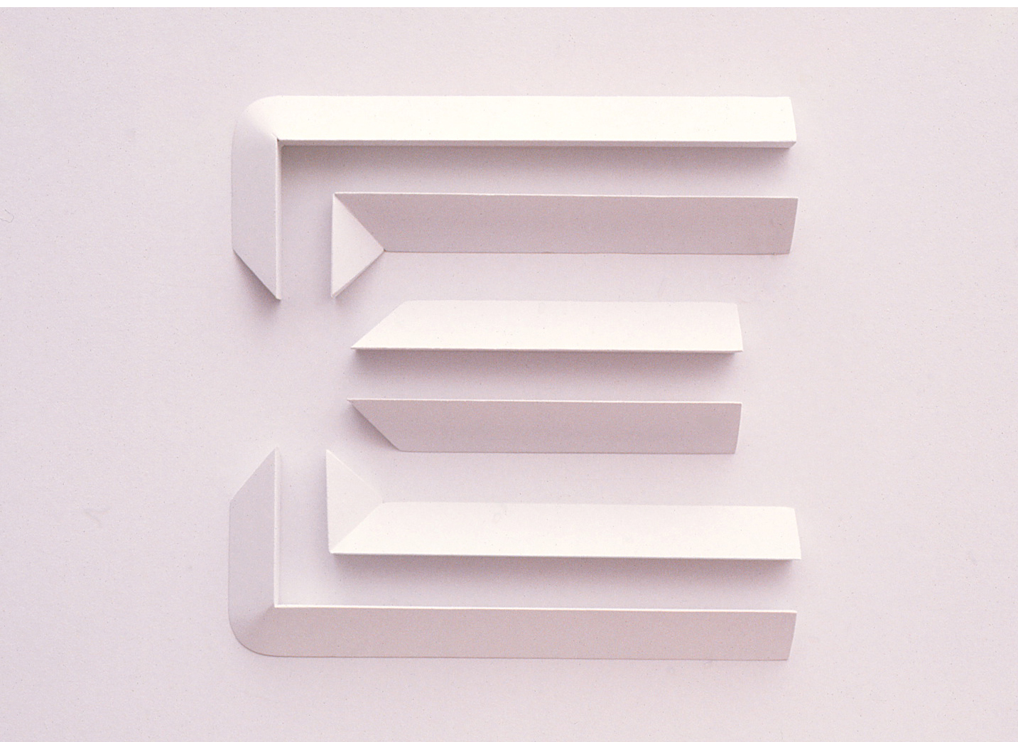 White sculpture of the E logo symbol featuring shadows to show depth and detail.